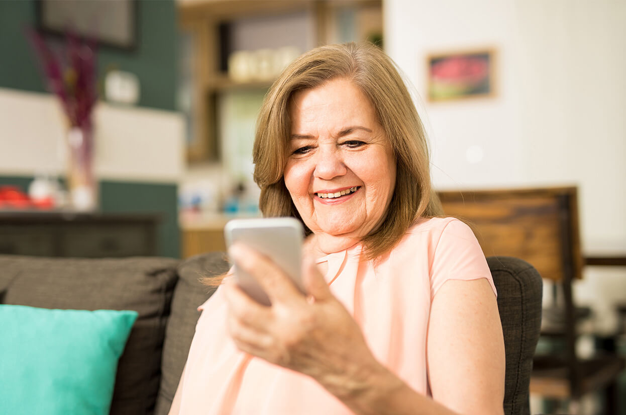 Older lady looking at her mobile phone