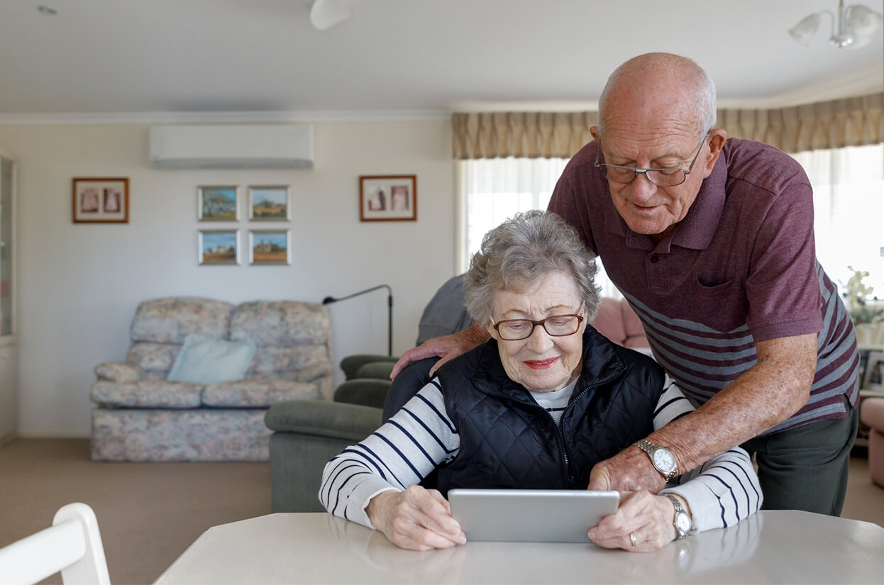 Older couple looking at an e-tablet